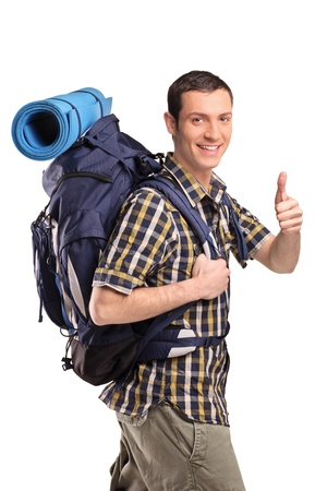 explorer: A portrait of a man in sportswear with backpack giving thumb up isolated on white background Stock Photo