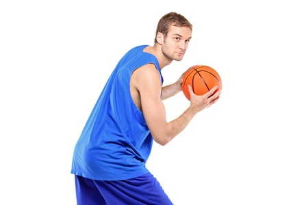 Portrait of a basketball player posing with a ball isolated against white background photo