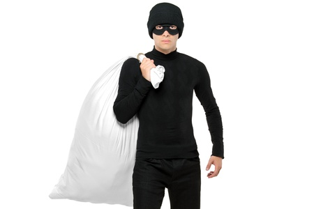 Portrait of a thief holding a bag isolated against white background photo