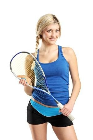 squash: Smiling female squash player posing isolated against white background Stock Photo
