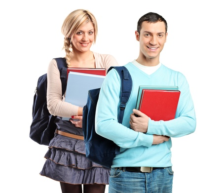 A couple of student holding books isolated on white background Stock Photo - 8584122