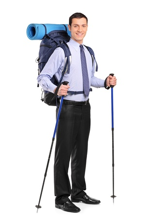 trekking pole: Full length portrait of a businessman in a suit with backpack and hiking poles isolated on white background