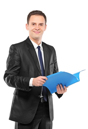 A confident businessman in black suit holding documents isolated on white background photo
