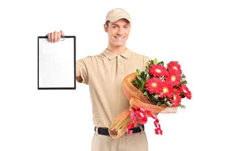 A delivery boy holding a bouquet of flowers and clipboard isolated on white background photo