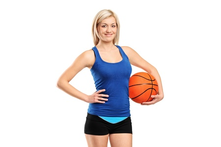 An attractive female holding a basketball isolated against white background photo