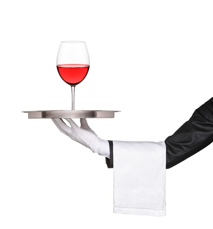 Hand holding a silver tray with a glass of wine on it isolated on white background photo