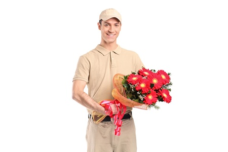 delivering: A delivery man delivering a bunch of flowers isolated on white background Stock Photo