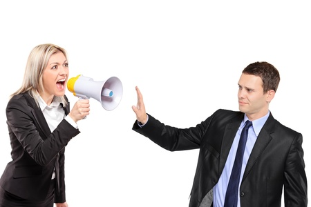 A frustated woman yelling via megaphone and man gesturing isolated on white background photo