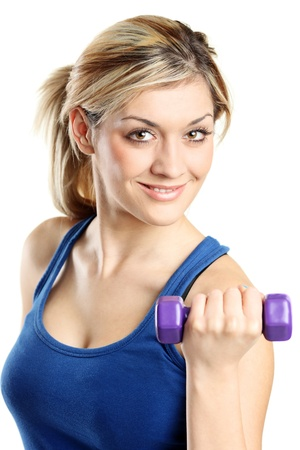 Close up of a young attractive woman with weights isolated on white background photo
