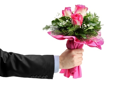 birthday suit: Hand holding bunch of roses isolated against white background
