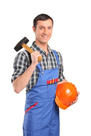 Male worker wearing blue overall with a hammer and helmet isolated on white background photo