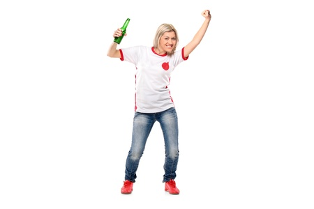 Full length portrait of excited female sport fan posing against white background  Stock Photo - 8711657