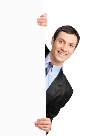 people from behind: Young businessman holding a blank billboard isolated on white background