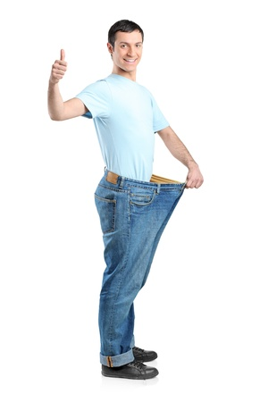 loss: Full length portrait of a weight loss male with thumb up isolated on white Stock Photo