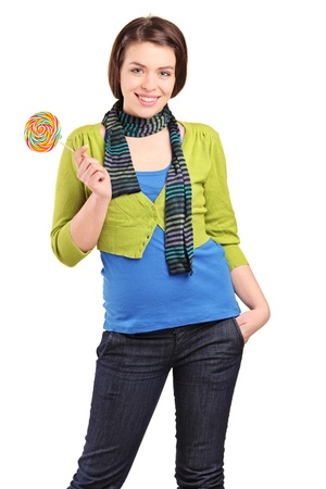 A happy young girl holding a lollypop isolated on white background photo