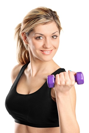 flex: A young attractive woman exercising with weights isolated on white background