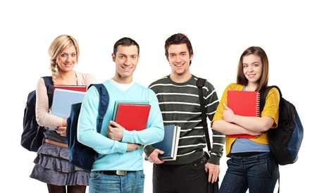 Four happy students posing with books isolated on white background photo
