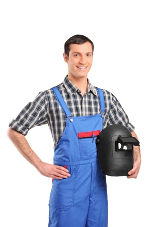 A worker wearing a overall and holding a welding mask isolated on white background Stock Photo - 8832732