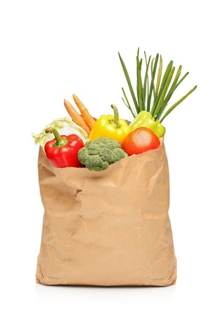 brown paper bags: A grocery bag full with fresh vegetables isolated on white background Stock Photo