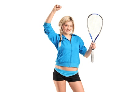 A happy female squash player posing isolated against white background photo