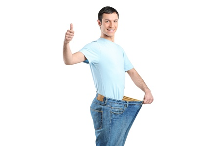diet concept: Portrait of a weight loss male with thumb up isolated on white
