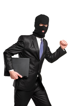 villain: A hacker in robbery mask running with laptop isolated against white background