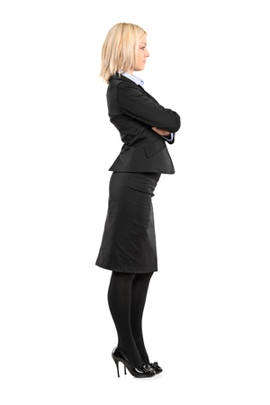 Full length portrait of a businesswoman waiting in line isolated against white background photo