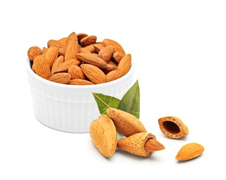 Almonds concept isolated against white background photo