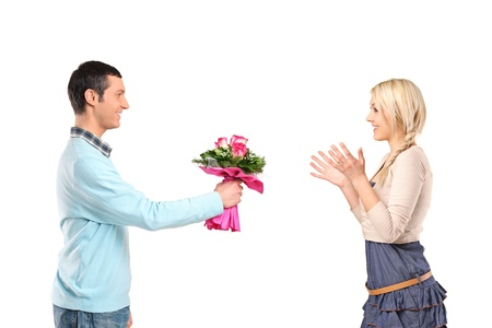 Boyfriend giving flowers to his surprised girlfriend isolated on white background photo