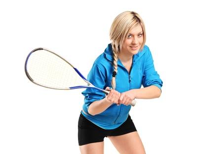 Female squash player posing isolated on white background photo