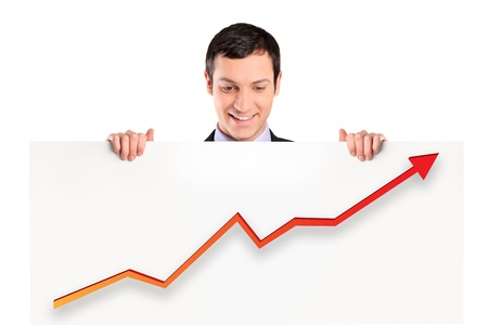 A smiling businessman holding a white panel with a growth graph isolated on white background photo
