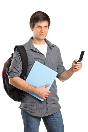 A young boy typing a text message on mobile phone isolated on white background photo