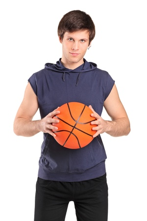 A young school boy holding a basketball isolated on white background photo