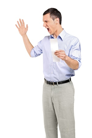 Angry man yelling after looking at store receipt isolated on white background Stock Photo - 8975369