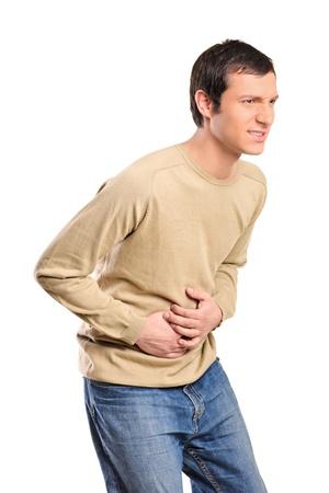 dolor de estomago: Joven sufre de un dolor de dolor de est�mago mal aislado sobre fondo blanco