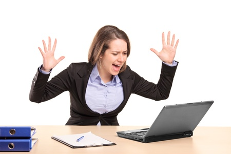 desperately: A nervous young businesswoman yelling isolated on white background