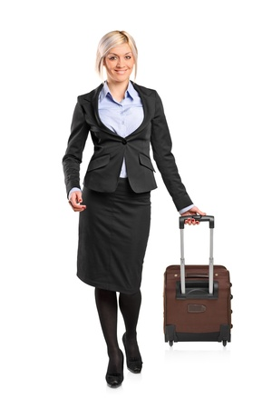 Full length portrait of a businesswoman carrying a suitcase isolated on white background Stock Photo - 9093573