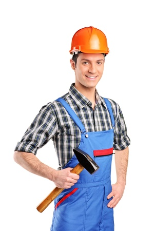 Manual worker wearing blue overall and holding a hammer isolated on white background Stock Photo - 9093840