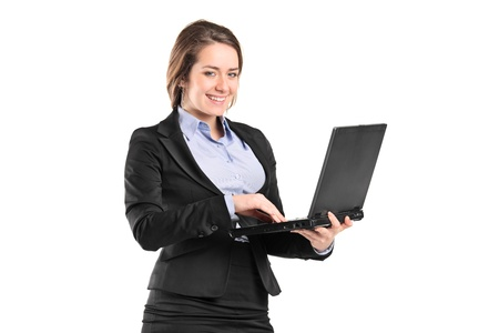 Portrait of a smiling young businesswoman working on a laptop isolated on white Stock Photo - 9093916