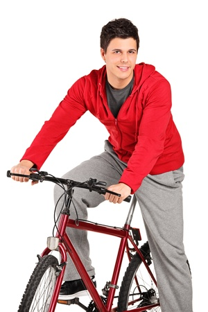 A smiling bicyclist on a bicycle posing isolated on white background photo