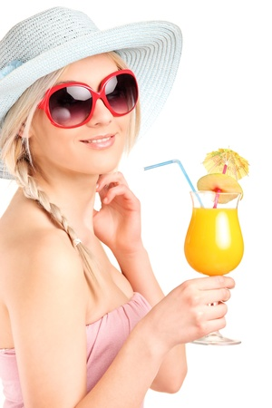 Attractive woman with sunglasses drinking a cocktail isolated on white background photo