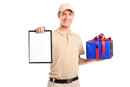 gift packs: Delivery person delivering a gift box and holding a clipboard isolated on white background