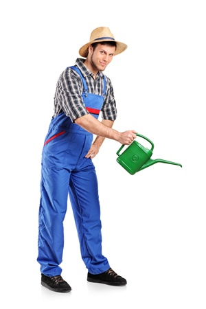 moisten: Full length portrait of a male gardener with watering can isolated on white background