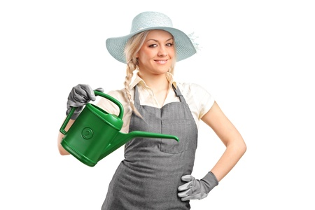 Portrait of a beautiful female gardener with watering can isolated on white background photo