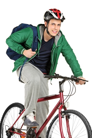 A young bicyclist on a bicycle posing isolated on white background photo