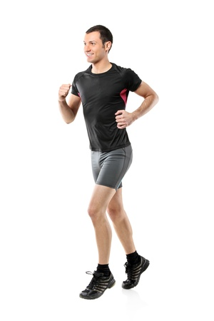 sportruházat: Full length portrait of a male athlete running isolated against white background
