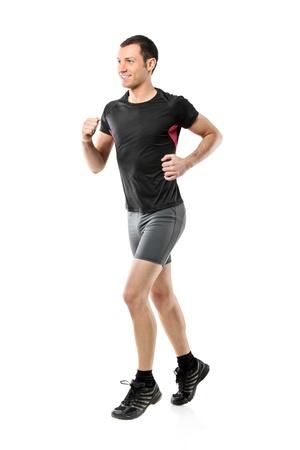 people jogging: Retrato de longitud completa de un atleta masculino ejecutando aislados sobre fondo blanco