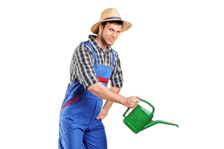 Portrait of a male gardener with watering can isolated on white background photo