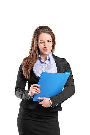 fascicule: Portrait of a young businesswoman holding documents isolated on white background