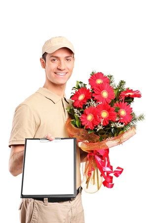 work wear: A delivery boy delivering bouquet of flowers and holding a clipboard isolated on white background Stock Photo